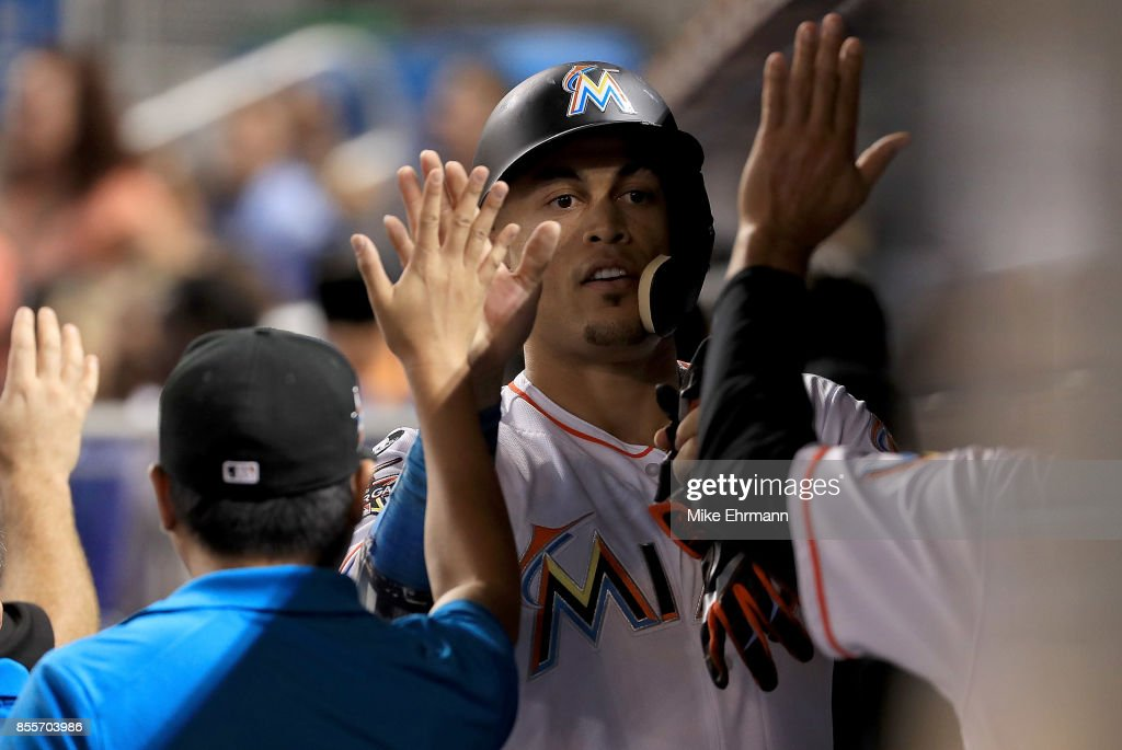 Giancarlo Stanton #27 of the Miami Marlins is congratulated after scoring during a game against the Atlanta Braves at Marlins Park on September 29, 2017 in Miami, Florida.