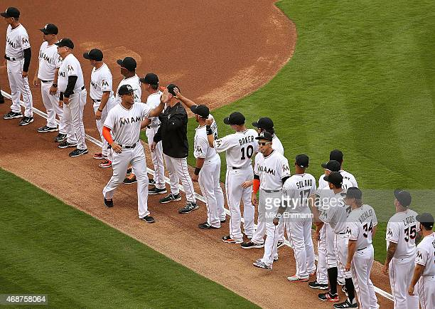 Giancarlo Stanton of the Miami Marlins is greeted during Opening Day against the Atlanta Braves at Marlins Park on April 6 2015 in Miami Florida