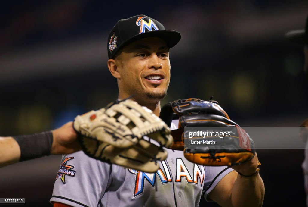 Giancarlo Stanton #27 of the Miami Marlins jogs off the field at the end of the seventh inning during game two of a doubleheader against the Philadelphia Phillies at Citizens Bank Park on August 22, 2017 in Philadelphia, Pennsylvania. The Marlins won 7-4.