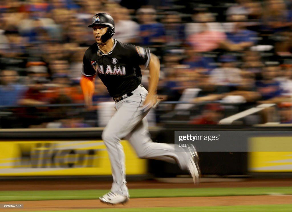 Giancarlo Stanton #27 of the Miami Marlins leads off from first base in the first inning against the New York Mets on August 18, 2017 at Citi Field in the Flushing neighborhood of the Queens borough of New York City.