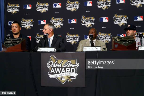 Giancarlo Stanton of the Miami Marlins Major League Baseball Commissioner Robert D Manfred Jr Hall of Famer Hank Aaron and Jose Altuve of the Houston...
