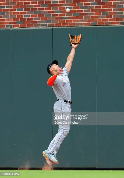 Giancarlo Stanton of the Miami Marlins makes a catch against the wall during the seventh inning the Atlanta Braves in the fifth inning at SunTrust...