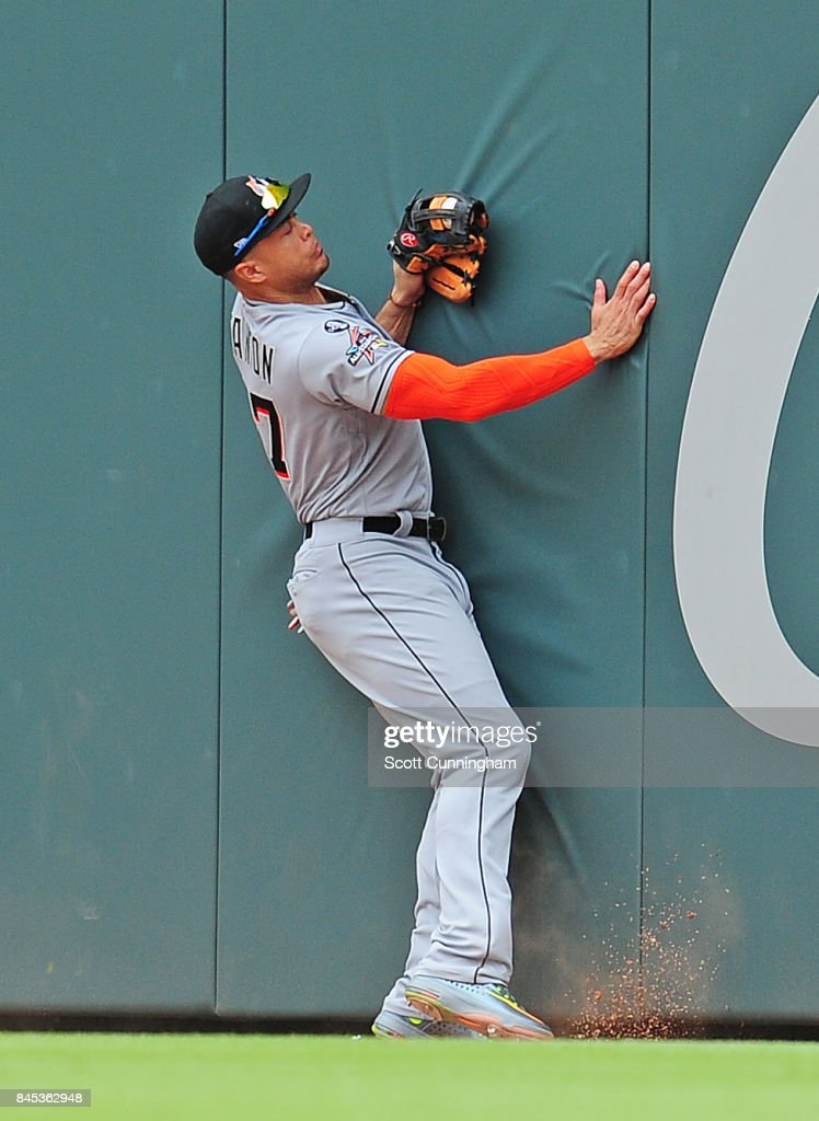 Giancarlo Stanton #27 of the Miami Marlins makes a catch against the wall during the seventh inning the Atlanta Braves in the fifth inning at SunTrust Park on September 10, 2017 in Atlanta, Georgia.