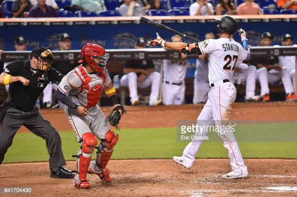 Giancarlo Stanton of the Miami Marlins reacts after being called out on strikes in the fifth inning against the Philadelphia Phillies at Marlins Park...