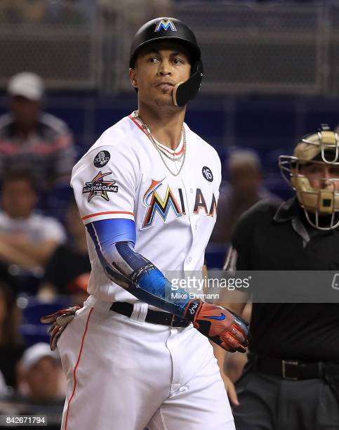 Giancarlo Stanton of the Miami Marlins reacts after striking out during a game against the Washington Nationals at Marlins Park on September 4 2017...