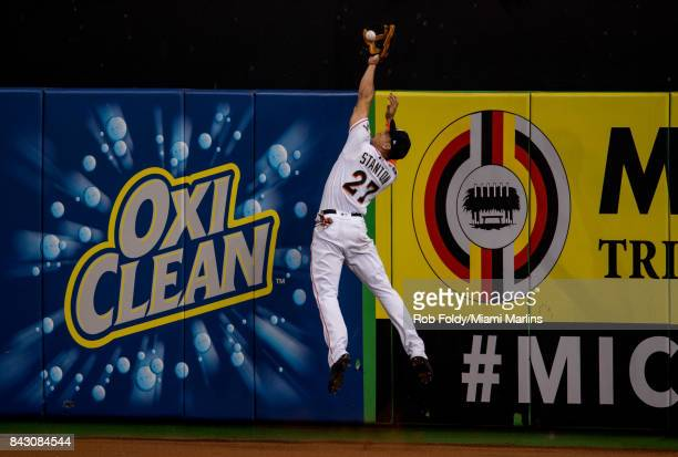 Giancarlo Stanton of the Miami Marlins robs a home run during the third inning of the game against the Washington Nationals at Marlins Park on...
