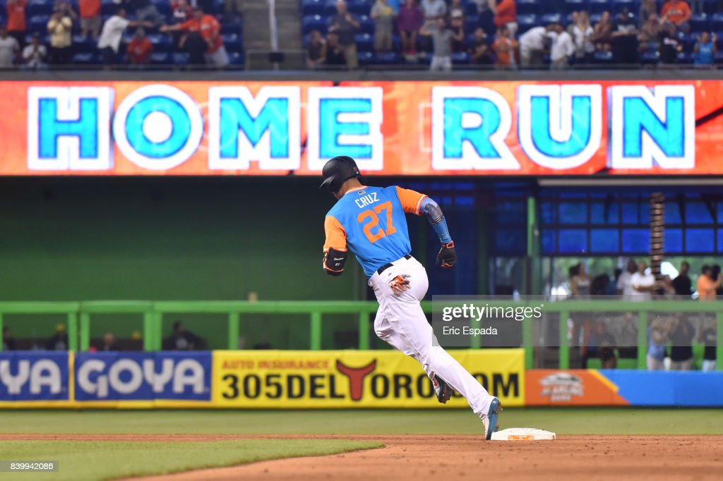 Giancarlo Stanton #27 of the Miami Marlins rounds second base after hitting his 50th home run of the season in the eighth inning against the San Diego Padres at Marlins Park on August 27, 2017 in Miami, Florida.