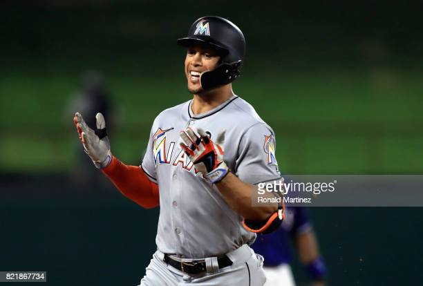 Giancarlo Stanton of the Miami Marlins runs the bases after hitting a home run against the Texas Rangers in the eighth inning at Globe Life Park in...