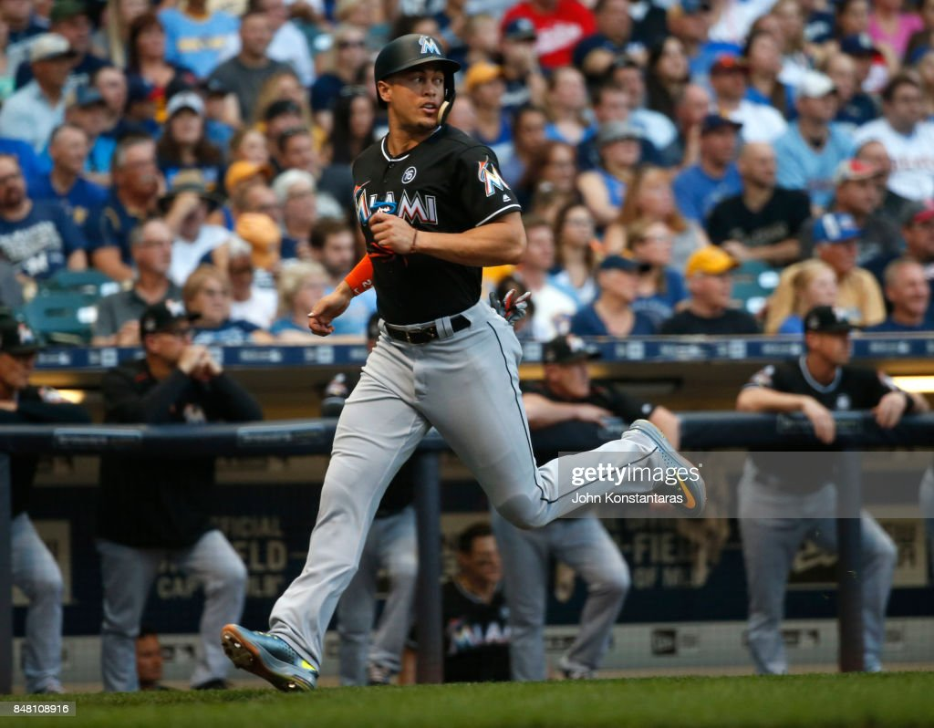 Giancarlo Stanton #27 of the Miami Marlins scores during the first inning at Miller Park on September 16, 2017 in Milwaukee, Wisconsin.