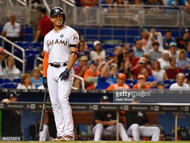 Giancarlo Stanton of the Miami Marlins smiles in the eighth during the game between the Miami Marlins and the Chicago Cubs at Marlins Park on June 23...