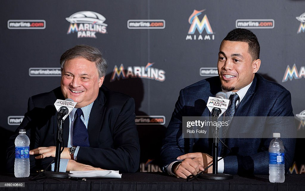 Giancarlo Stanton of the Miami Marlins speaks as owner Jeffrey Loria looks on during a press conference at Marlins Park on November 19, 2014 in Miami, Florida.