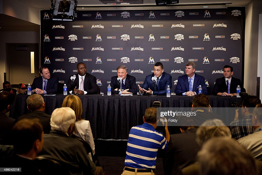 Giancarlo Stanton of the Miami Marlins speaks during a press conference as manager Mike Redmond (left), President of Baseball Operations Michael Hill (second from left), owner Jeffrey Loria (center left), Vice President & General Manager Dan Jennings (second from right), and President David Samson (right) look on at Marlins Park on November 19, 2014 in Miami, Florida.