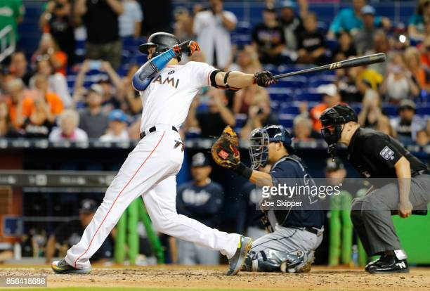 Giancarlo Stanton of the Miami Marlins strikes out in the ninth inning in front of Kurt Suzuki of the Atlanta Braves ending his bid for 60 home runs...
