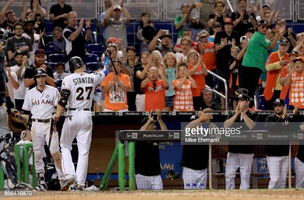 Giancarlo Stanton of the Miami Marlins takes a curtain call during a game against the Atlanta Braves at Marlins Park on October 1 2017 in Miami...