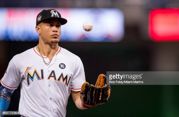 Giancarlo Stanton of the Miami Marlins tosses a ball in the air during the game against the Atlanta Braves at Marlins Park on September 29 2017 in...