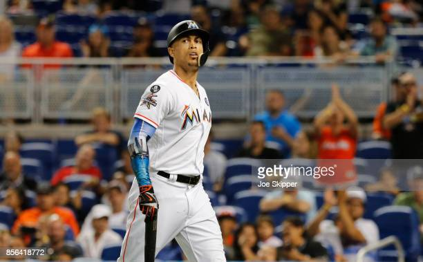 Giancarlo Stanton of the Miami Marlins walks to the dugout striking out in the ninth inning of play against the Atlanta Braves ending his bid for 60...
