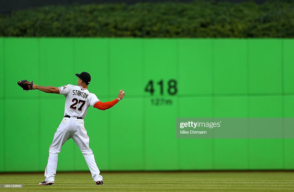 Giancarlo Stanton #27 of the Miami Marlins warms up during a game against the Milwaukee Brewers at Marlins Park on May 23, 2014 in Miami, Florida.