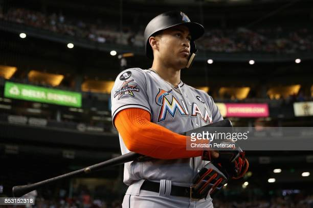 Giancarlo Stanton of the Miami Marlins warms up on deck during the first inning of the MLB game against the Arizona Diamondbacks at Chase Field on...