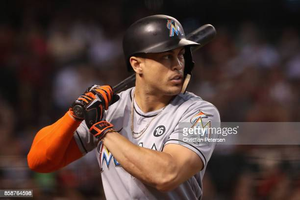 Giancarlo Stanton of the Miami Marlins warms up on deck during the MLB game against the Arizona Diamondbacks at Chase Field on September 24 2017 in...