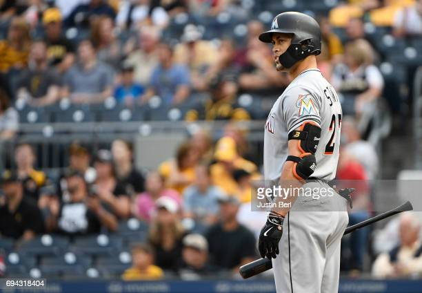 Giancarlo Stanton of the Miami Marlins watches a replay review on the scoreboard in the first inning during the game against the Pittsburgh Pirates...