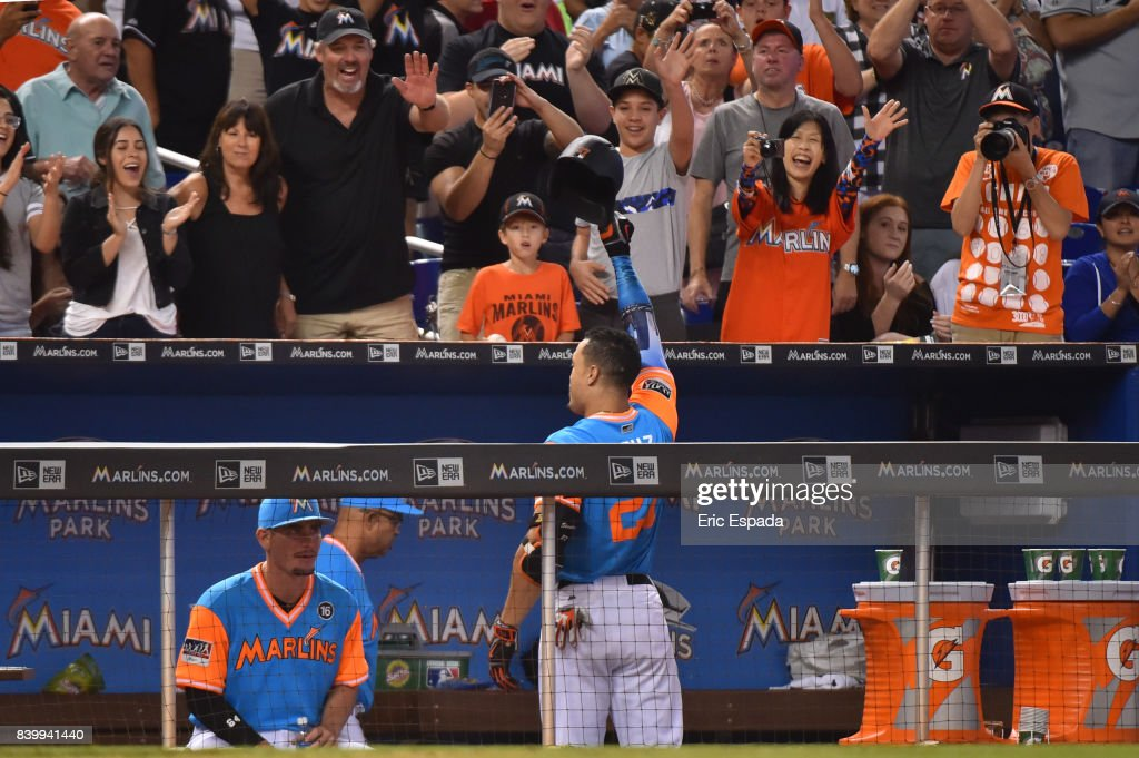 Giancarlo Stanton #27 of the Miami Marlins waves to the fans after hitting his 50th homer of the season in the eighth inning against the San Diego Padres at Marlins Park on August 27, 2017 in Miami, Florida.