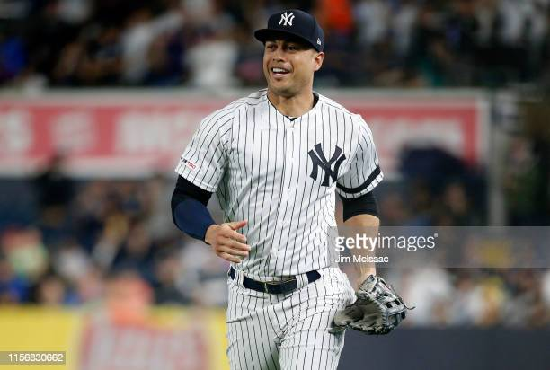 Giancarlo Stanton of the New York Yankees as he runs to the dugout after the first inning against the Tampa Bay Rays at Yankee Stadium on June 18,...