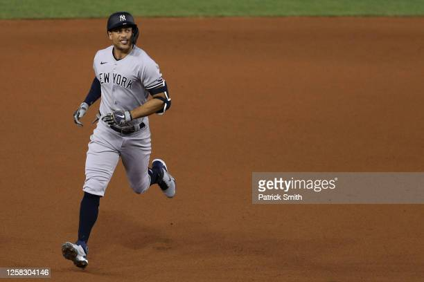 Giancarlo Stanton of the New York Yankees celebrates a solo home run against the Washington Nationals during the fourth inning at Nationals Park on...