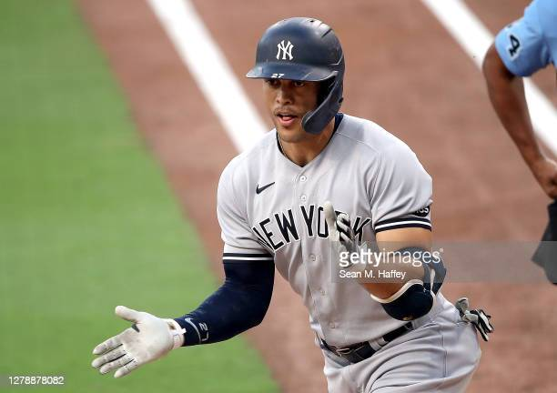 Giancarlo Stanton of the New York Yankees celebrates after hitting a solo home run against the Tampa Bay Rays during the second inning in Game Two of...