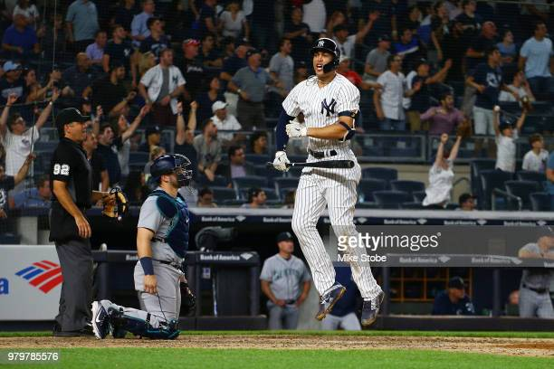 Giancarlo Stanton of the New York Yankees celebrates after hitting a walkoff 2run home run in the bottom of th eninth inning agaist the Seattle...