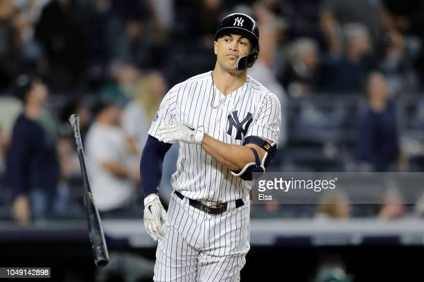 Giancarlo Stanton of the New York Yankees celebrates after scoring a solo home run against the Oakland Athletics during the eighth inning in the...