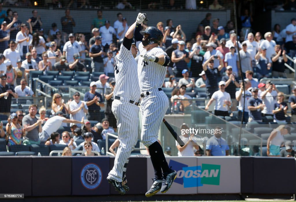 Giancarlo Stanton #27 of the New York Yankees celebrates his fifth inning home run against the Tampa Bay Rays with teammate Gary Sanchez #24 at Yankee Stadium on June 16, 2018 in the Bronx borough of New York City.