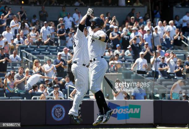 Giancarlo Stanton of the New York Yankees celebrates his fifth inning home run against the Tampa Bay Rays with teammate Gary Sanchez at Yankee...