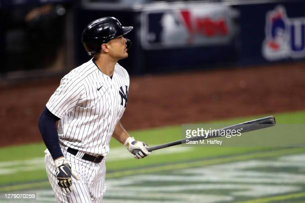 Giancarlo Stanton of the New York Yankees celebrates his two run home run against the Tampa Bay Rays during the eighth inning in Game Three of the...