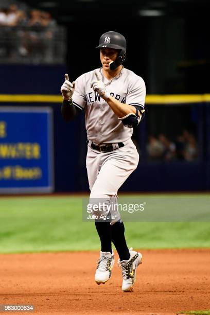 Giancarlo Stanton of the New York Yankees celebrates while running the bases on his home run in the eighth inning against the Tampa Bay Rays on June...