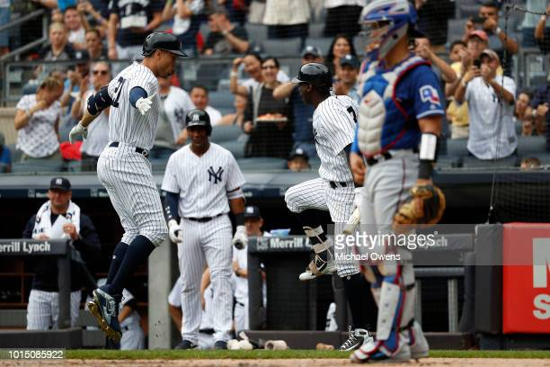 Giancarlo Stanton of the New York Yankees celebrates with Didi Gregorius of the New York Yankees after hitting a homerun in the first inning against...