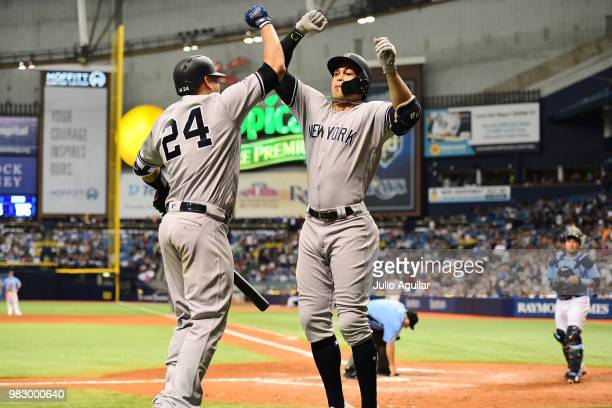 Giancarlo Stanton of the New York Yankees celebrates with teammate Gary Sanchez after hitting a homer in the eighth inning against the Tampa Bay Rays...
