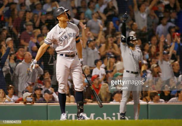 Giancarlo Stanton of the New York Yankees connects for a grand slam home run against the Boston Red Sox in the eighth inning at Fenway Park on...