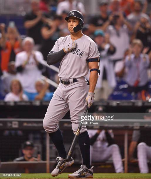 Giancarlo Stanton of the New York Yankees gets a standing ovation before his first at bat in the first inning against the Miami Marlins at Marlins...