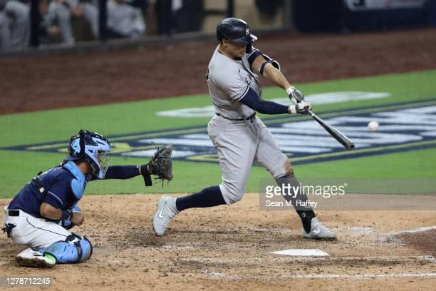 Giancarlo Stanton of the New York Yankees hits a grand slam against the Tampa Bay Rays during the ninth inning in Game One of the American League...