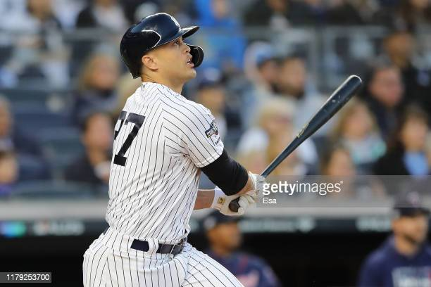 Giancarlo Stanton of the New York Yankees hits a sacrifice fly to score Aaron Judge in the third inning of game two of the American League Division...