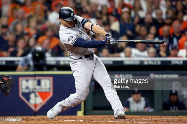 Giancarlo Stanton of the New York Yankees hits a solo home run against the Houston Astros during the sixth inning in game one of the American League...
