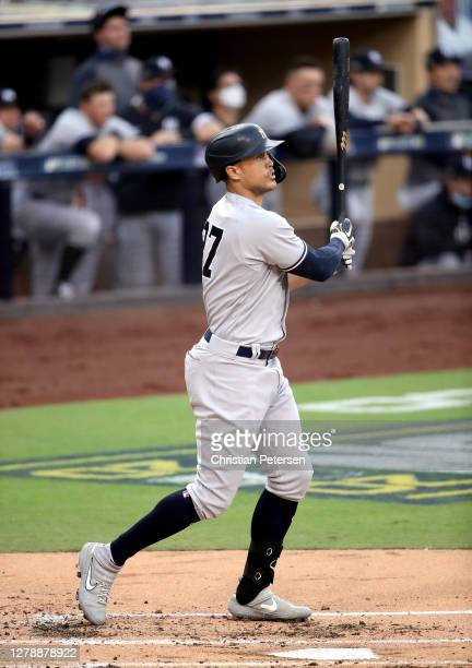 Giancarlo Stanton of the New York Yankees hits a solo home run against the Tampa Bay Rays during the second inning in Game Two of the American League...