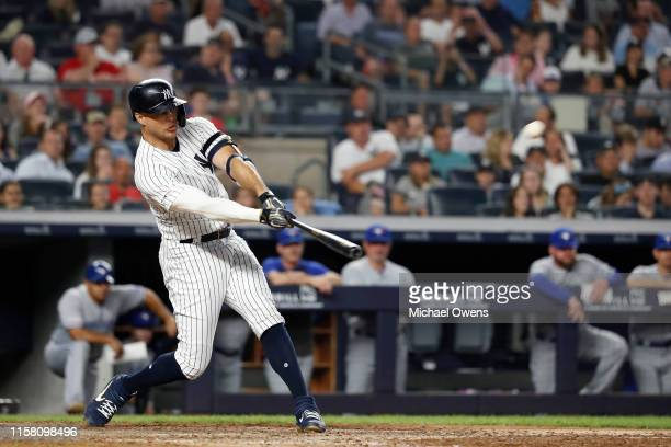 Giancarlo Stanton of the New York Yankees hits a three run home run against the Toronto Blue Jays in the sixth inning at Yankee Stadium on June 24,...