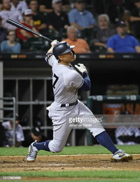 Giancarlo Stanton of the New York Yankees hits a two run home run in the 10th inning against the Chicago White Sox at Guaranteed Rate Field on August...