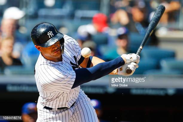 Giancarlo Stanton of the New York Yankees hits an infield single in the third inning against the Toronto Blue Jays at Yankee Stadium on September 16...