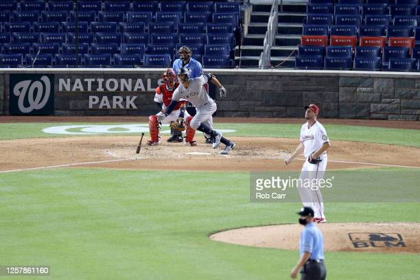 Giancarlo Stanton of the New York Yankees hits an RBI single to right field against Max Scherzer of the Washington Nationals in the game at Nationals...