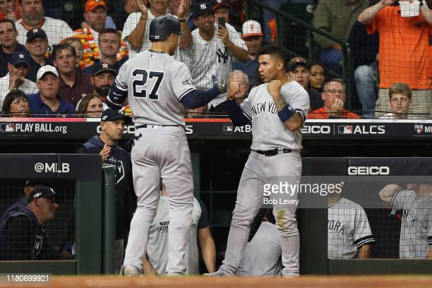 Giancarlo Stanton of the New York Yankees is congratulated by his teammate Gleyber Torres after his solo home run against the Houston Astros during...