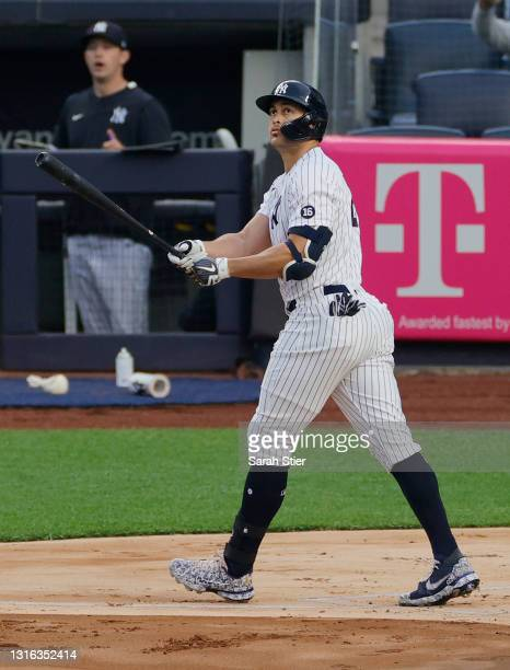 Giancarlo Stanton of the New York Yankees looks on after hitting a two-run home run during the first inning against the Houston Astros at Yankee...