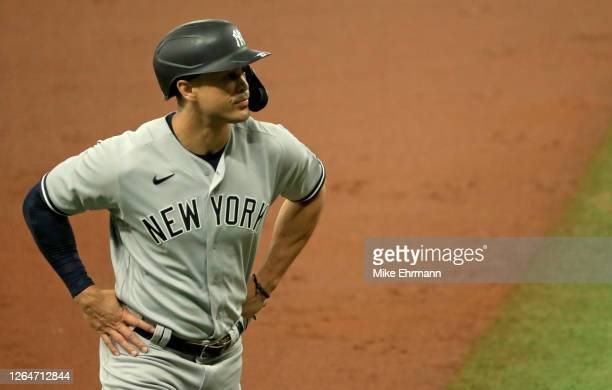 Giancarlo Stanton of the New York Yankees looks on during Game 1 of a doubleheader against the Tampa Bay Rays at Tropicana Field on August 08, 2020...