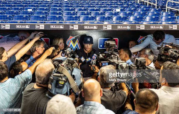 Giancarlo Stanton of the New York Yankees meeting with members of the media before the game against the Miami Marlins at Marlins Park on August 21...